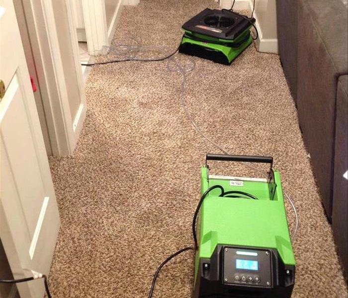 Drying equipment on carpet.