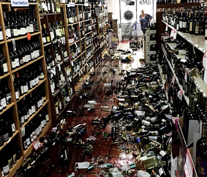a liquor store with hundreds of broken wine bottles