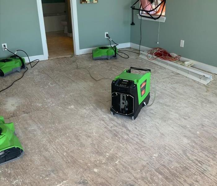 water damage in a residential home. air movers are in action.