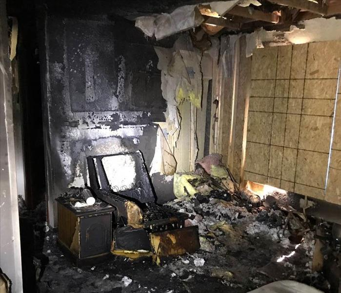 Severely fire damaged living room.