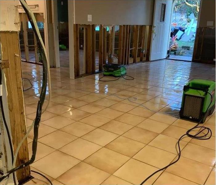 wet floor in a home and drying equipment placed in damaged area