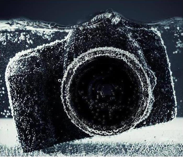 DSLR camera close up under water